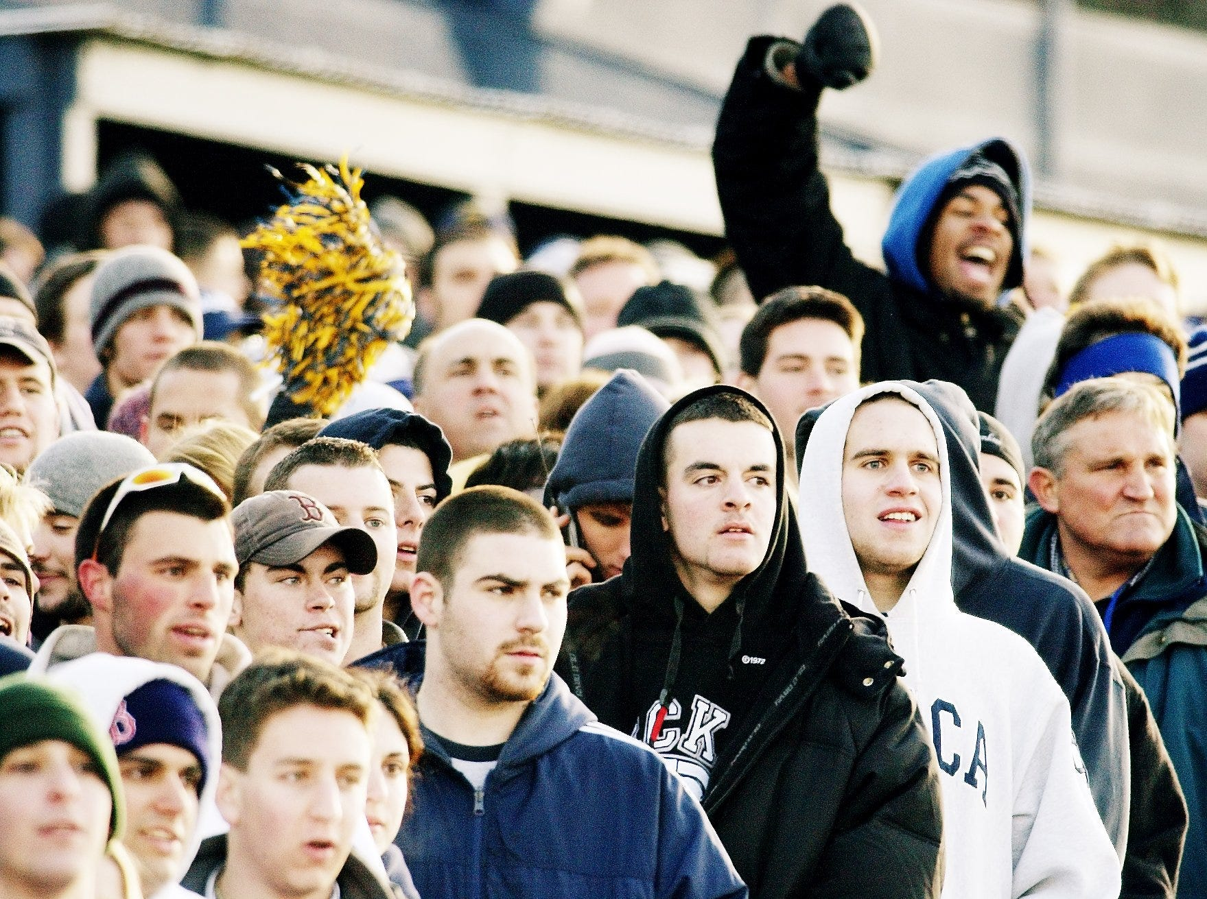"""2003: Fans react during the 45th annual """"Cortaca"""" Jug football game held Saturday at Ithaca College. Ryan DeCamp made a 26-yard field goal as time expired to give Cortland State a 16-15 victory over Ithaca, the Red Dragons' second consecutive win over IC. An overflow crowd of 11,743 watched the game."""