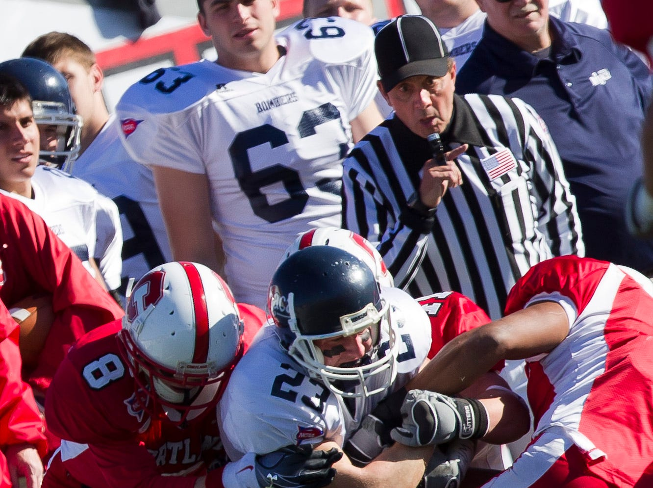2010: Ithaca College's Dan Ruffrage is taken down by SUNY Cortland's Phil Bossman and Joe Lopaz during Saturday's Cortaca Jug in Cortland.