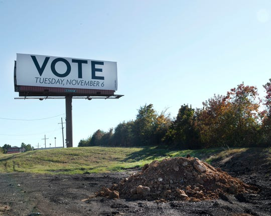 A 'Get Out the Vote' billboard is posted near the conjunction of 220 and Industrial Blvd. in Jackson. Saturday, Oct. 28, 2018.