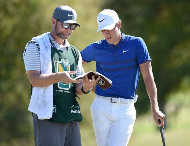 Cameron Champ and his caddy Kurt Kowaluk look at the book on the fifth green on Sunday, October 28, 2018, in the final round of the Sanderson Farms Championship at the Country Club of Jackson in Jackson, Mississippi.