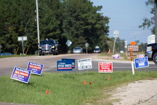 Several political signs are placed at the intersection of Mississippi 603 and Kiln-Delisle Road in Kiln ahead of the Nov. 6 general election. A matchup of note is the Senate race between Republicans Cindy Hyde-Smith and Chris McDaniel and Democrat Mike Espy.