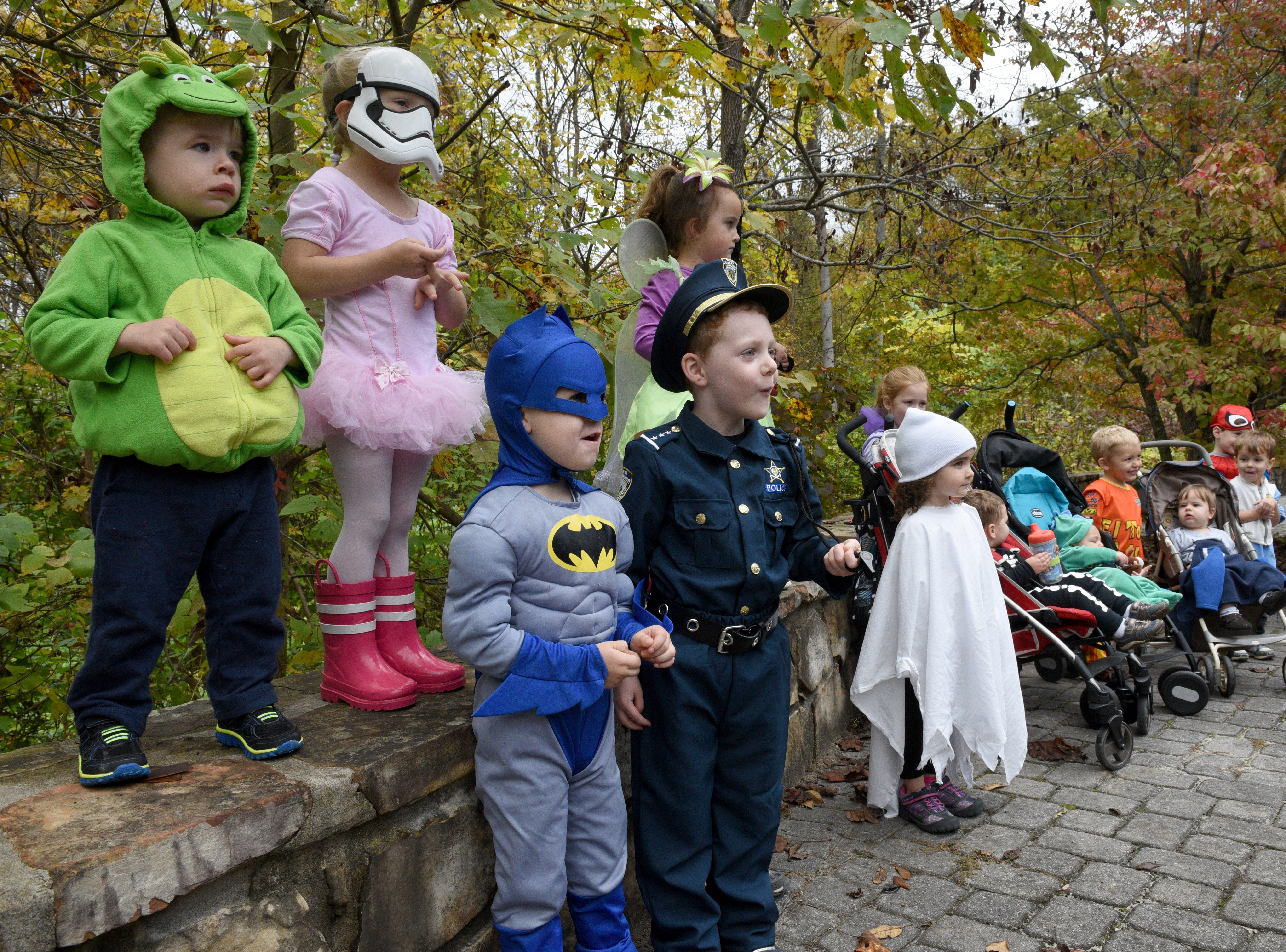 Posing for a group photo before the start of Ijams Nature Center's Little Tykes Halloween Hikes around the park Thursday, Oct. 29, 2015.