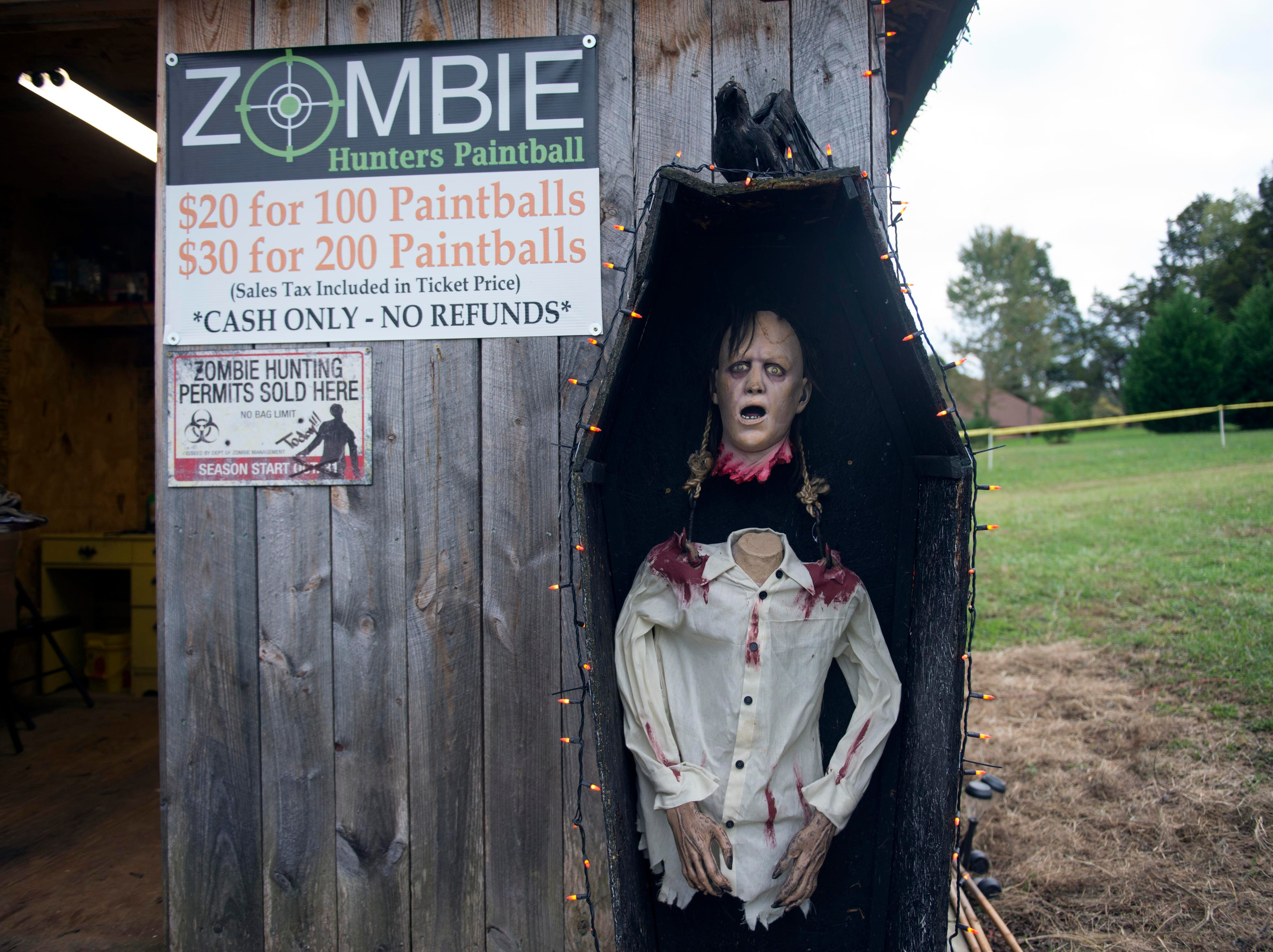 A Halloween decoration greets guests when they arrive to participate in Dead Man's Farm's Zombie Hunters Paintball on Thursday, October 16, 2014.