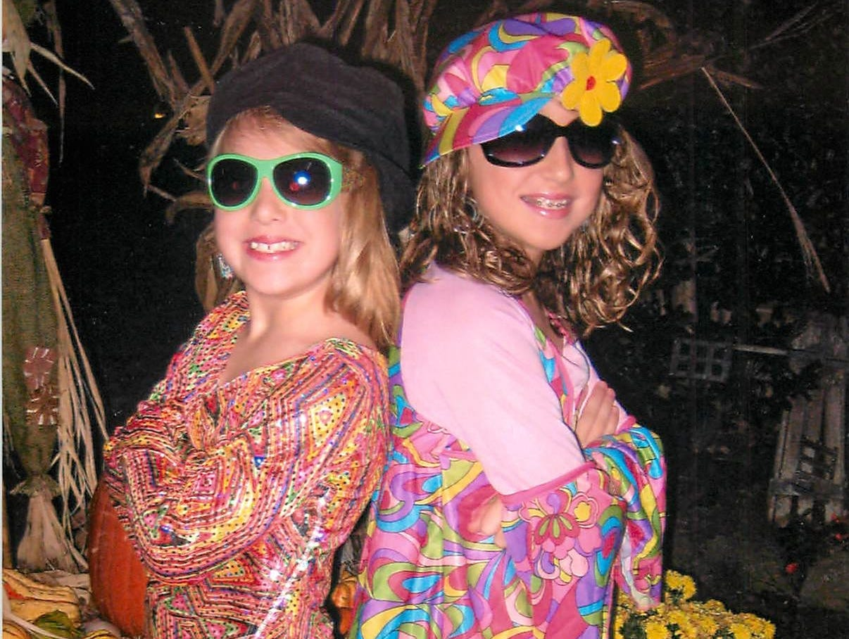 From left, seven-year-old Madison Percell and 11-year-old  Morgan Davenport  give their grooviest smiles on Halloween 2010.  Madison is daughter of Missy Percell and Clark Percell of Knoxville and Morgan is daughter of Missy Percell and Jason Davenport of Knoxville.