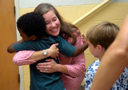 "Republican state Senator Jamie Woodson, also the chairman of the Senate Education Committee, hugs a student at Mooreland Heights Elementary School in south Knoxville after announcing the new ""Value Plus Schools"" program. The five year initiative will integrate art into the core curriculum at each grade level."