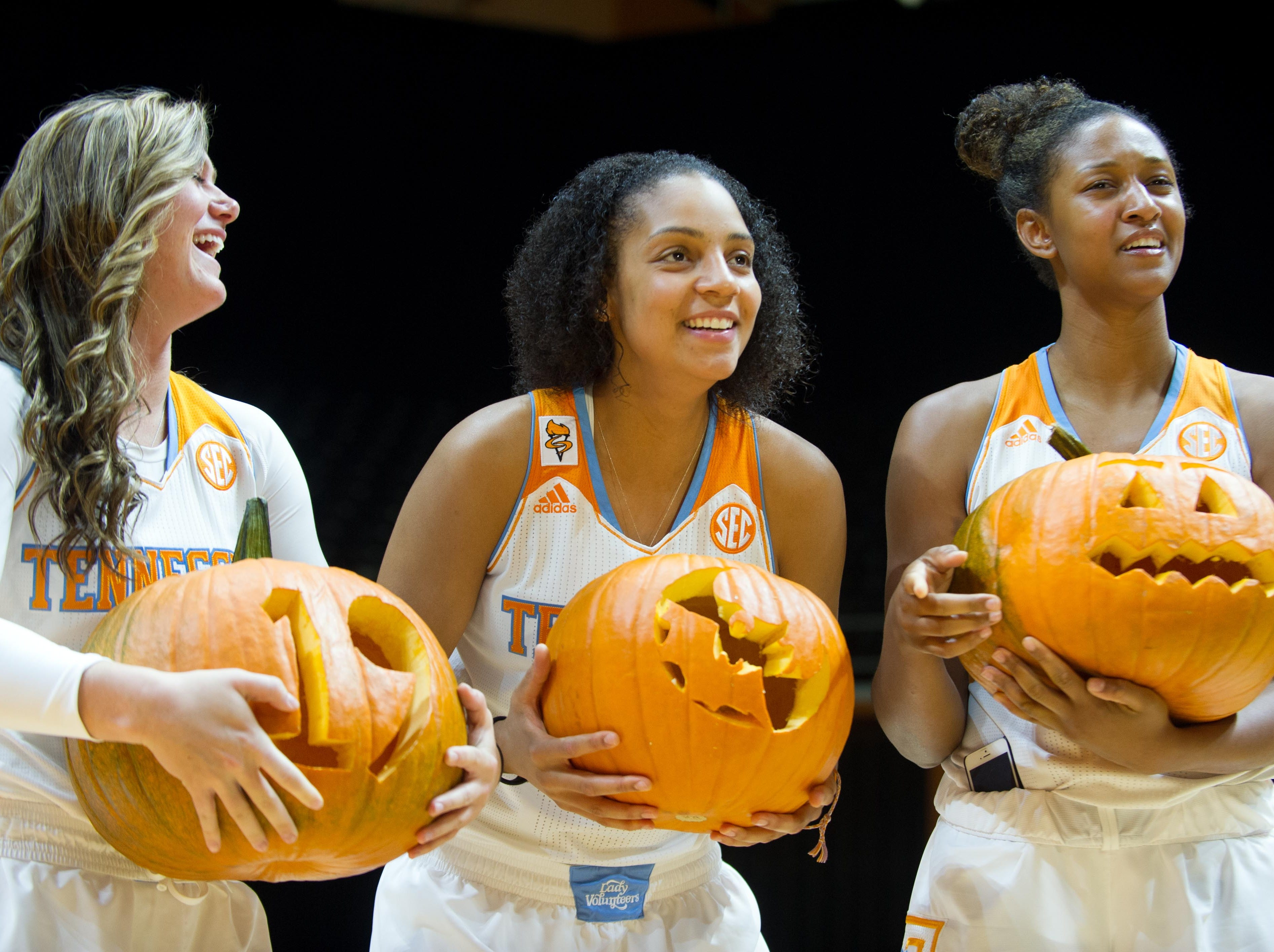 Tennessee players, from left, Alexa Middleton, Cierra Burdick, and Jaime Nared show off their carved pumpkins during Media Day at Thompson-Boling Arena on Wednesday, October 29, 2014. The number 19 is carved in Middleton's pumpkin because she turns 19 on Halloween. A silhouette of a bat decorates Burdick's pumpkin, and Nared's is a classic Jack-o'-lantern face with a Power T carved on the opposite side.
