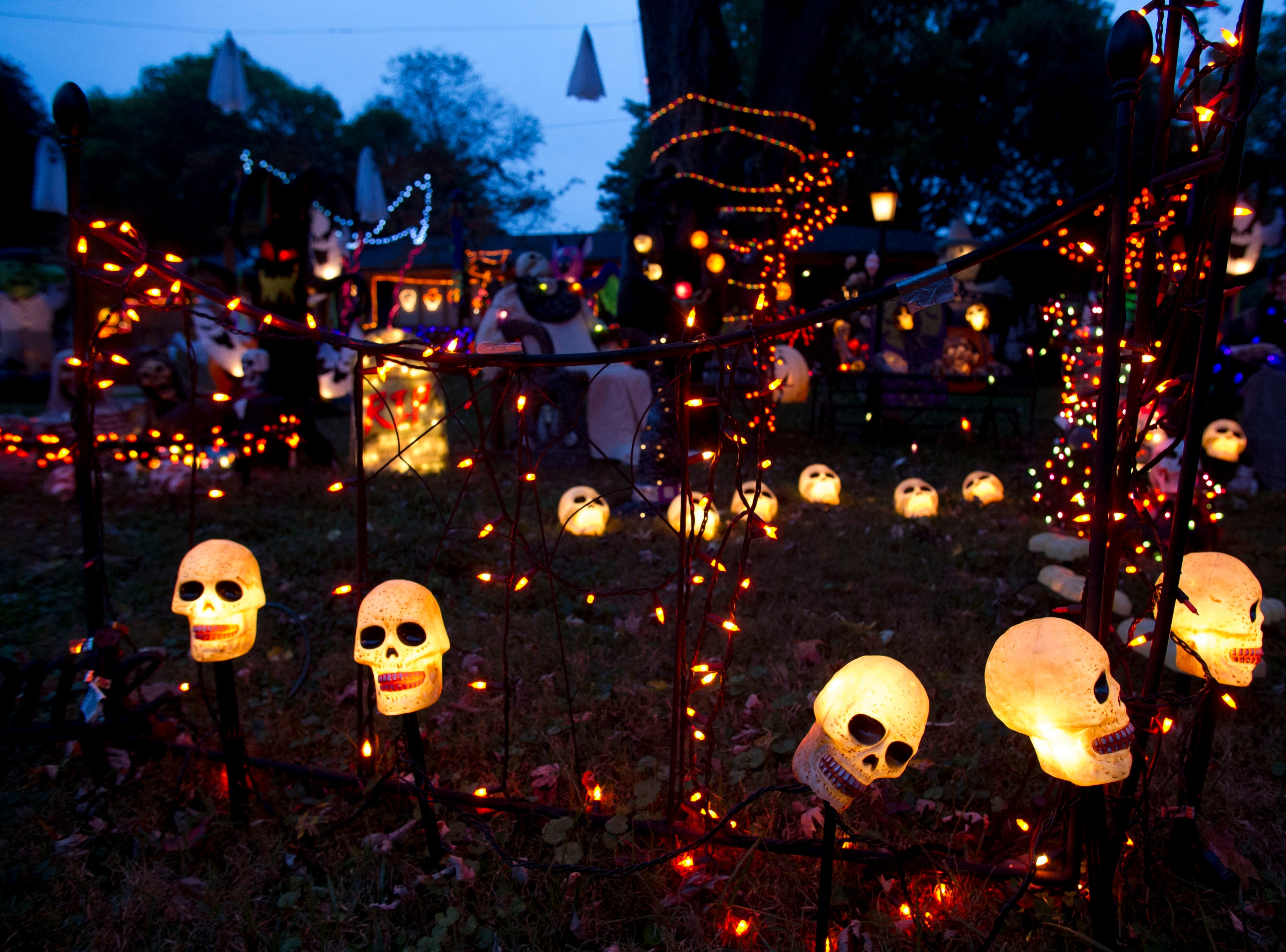Hundreds of Halloween decorations cover the yard of  Tom Freeman and Lane Freeman's home in West Hills on Wednesday, October 16, 2013.