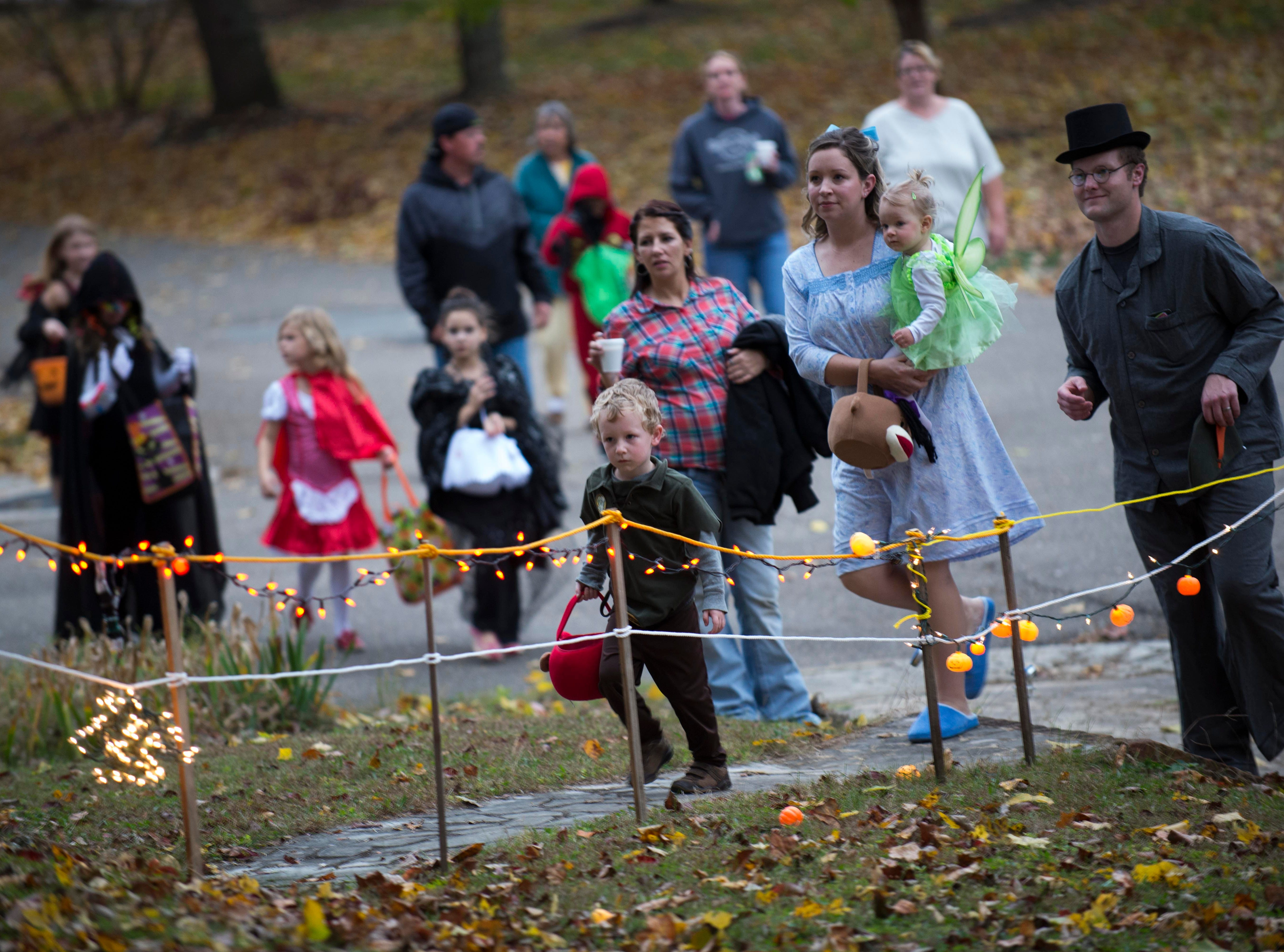 Trick or treaters haunt Island Home Boulevard on Thursday, Oct. 31, 2013, in South Knoxville.