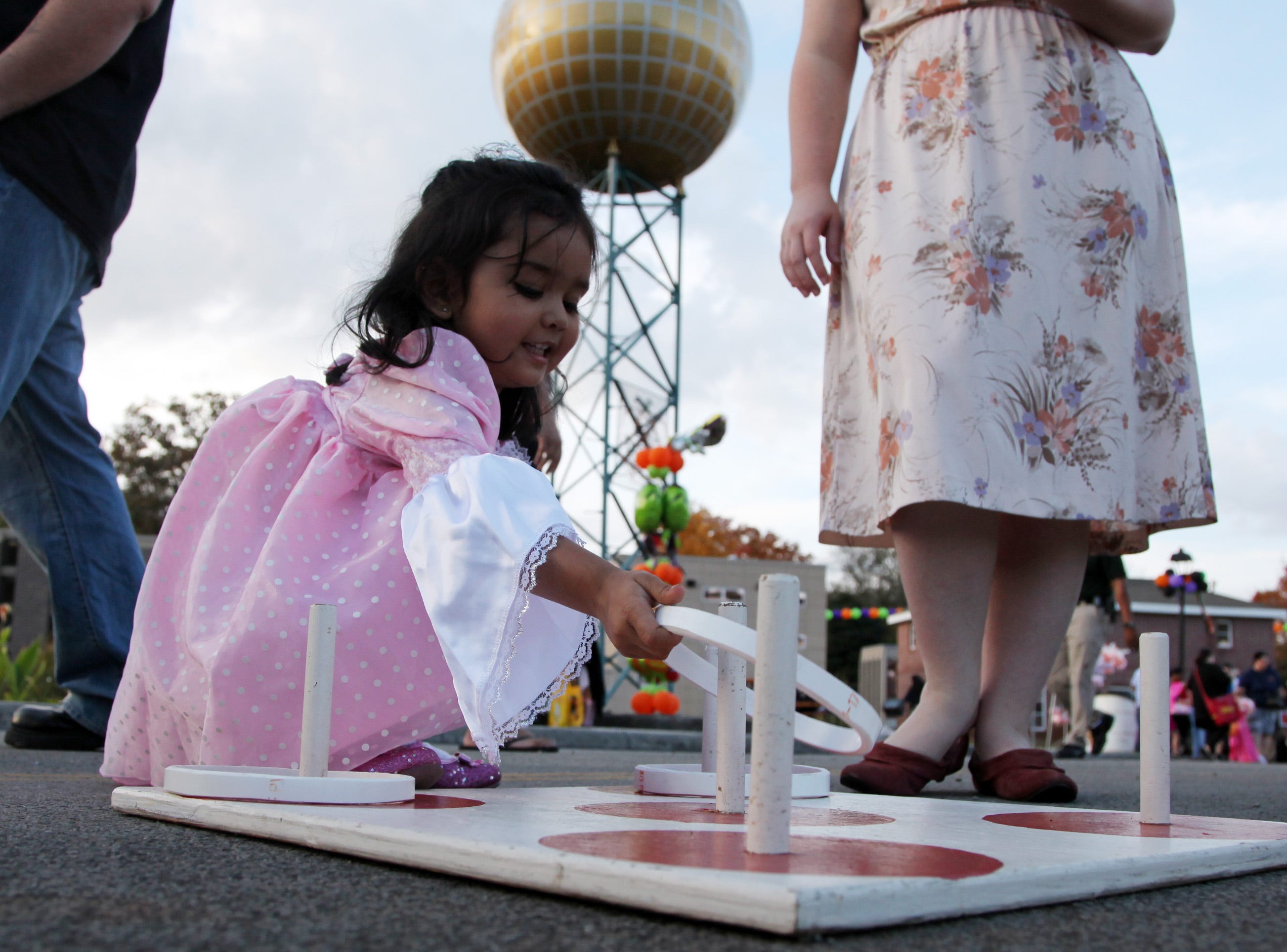 Aisha Patel (cq), 2, plays a ring game during the Knoxville Police Department's Halloween in the City at Safety City Friday, Oct. 30, 2009.