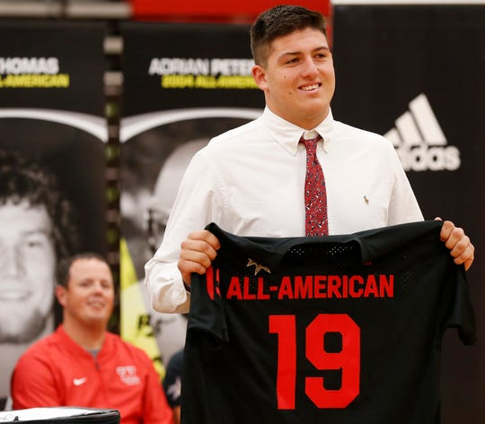 George Karlaftis is all smiles as he shows his jersey for the All-American Bowl presented by American Family Insurance Monday, October 29, 2018, at West Lafayette High School.