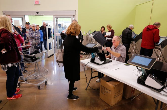 Residents line up to cast ballots during early voting Monday, October 29, 2018, at the Pay Less Supermarket in West Lafayette.