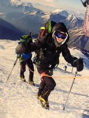 Louisiana native Isabella de la Houssaye climbs Mount Elbrus, the tallest mountain in Europe, with her son in July. She was diagnosed with cancer in January and wants to finish scaling the tallest summits on each continent. Next is Aconcagua in South America.