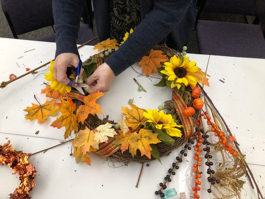 Subscribers make holiday wreaths with reporter Leigh Guidry and fellow Daily Advertiser newsroom staff at a wreath-making workshop for Insiders.