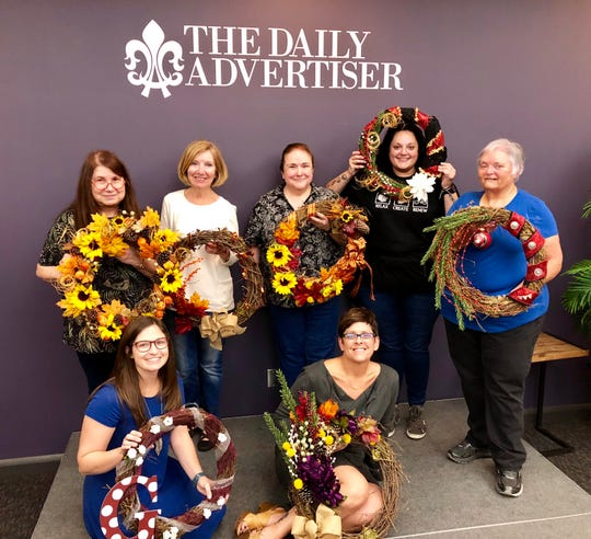 The Daily Advertiser hosted a holiday wreath-making workshop Wednesday night as an Insider perk. Subscribers could buy tickets for $10 and create a handmade wreath with help from our resident crafter (and reporter) Leigh Guidry. We provided the tools, materials, wine and cheese, and it was a great time. Showing off their creations are, standing from left, Gaylen Delcambre, Kathy Mills, Priscilla Deville, Jennifer Hiatt and Jan Hiatt. Sitting are reporter Leigh Guidry and news director Kristin Askelson.