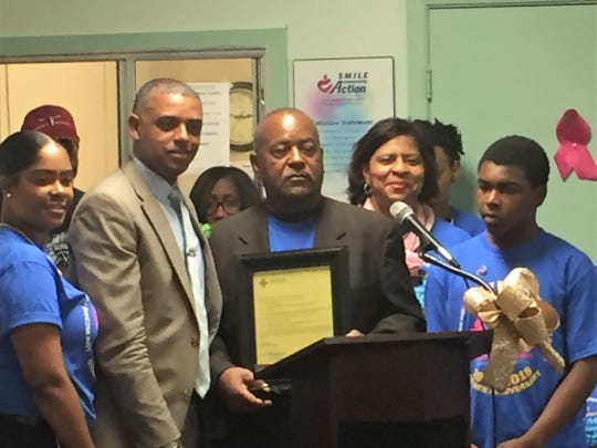 Lafayette Parish School Board member Elroy Broussard holds a proclamation at an October 2018 event. At the Jan. 17, 2018 school board meeting, Broussard said there needs to be more effort toward filling vacant teacher slots at low-rated schools.