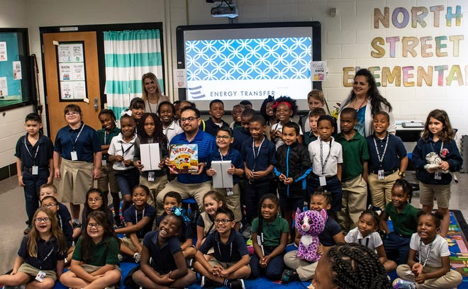 Energy Transfer Operations Supervisor Joel Hasette with students in Tonia Lajaunie's second-grade class at North Elementary School in New Iberia.