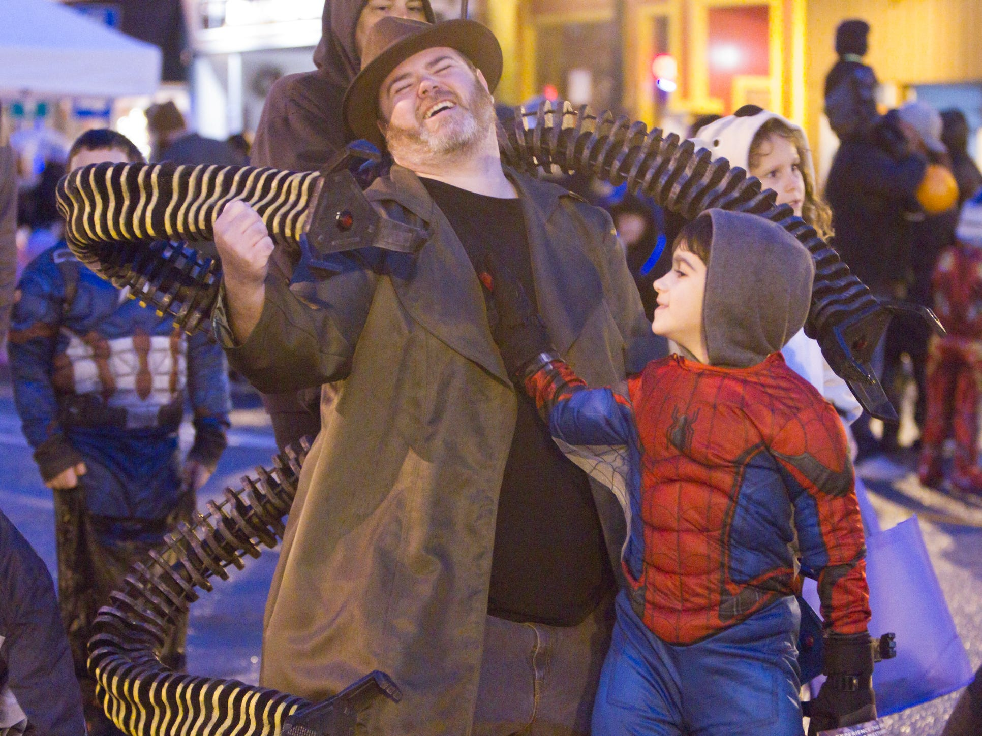 8-year-old Xavier Cooley as Spiderman puts some hurt on dad Tim Cooley as Dr. Octopus at the Legend of Sleepy Howell Saturday, Oct. 27, 2018.