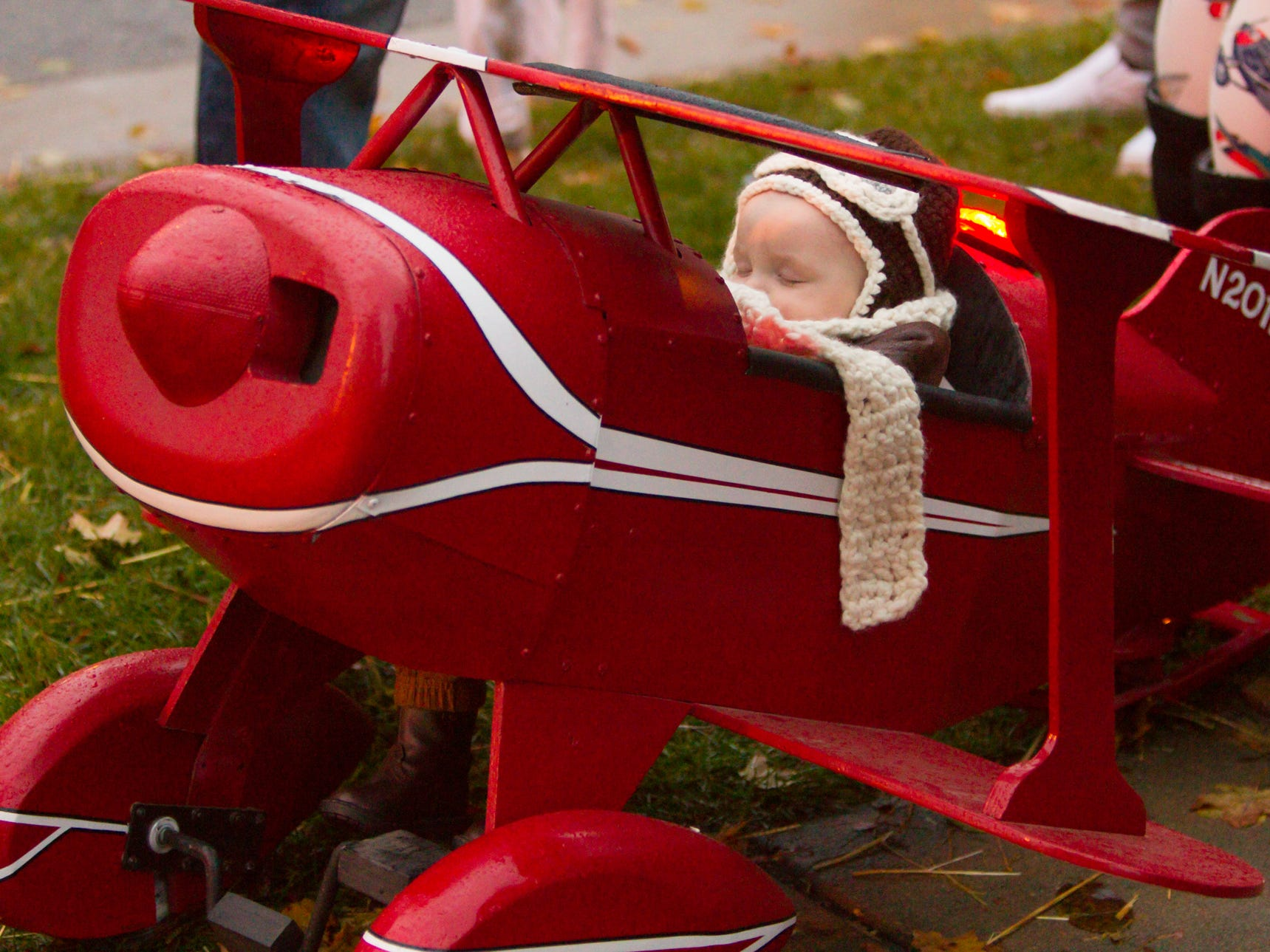 8 1/2-month-old Maverick Walker is asleep at the cockpit of a plane made by Maverick's grandfather for Maverick's father, at the Legend of Sleepy Howell Saturday, Oct. 27, 2018.