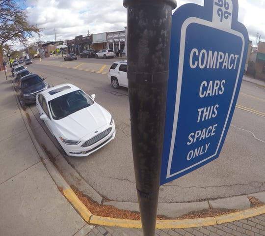 Parallel parking in downtown Brighton, shown Monday, Oct. 29, 2018, is part of an investigation on improving parking availability in the area.
