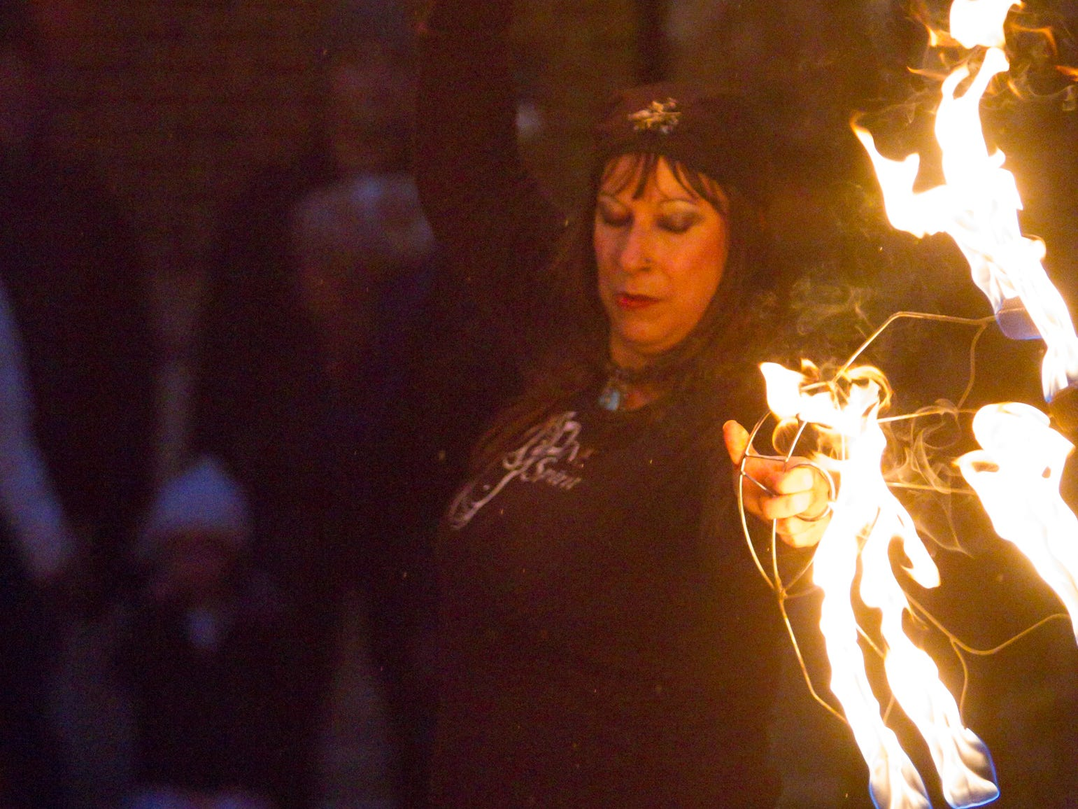 Kelly Hassan of One Spirit Dance and Fitness is among members of the troupe performing a fire dance at the Legend of Sleepy Howell Saturday, Oct. 27, 2018.