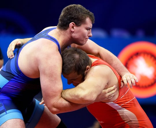 Fowlerville's Adam Coon (left) wrestles Sergey Semenov of Russia in the final match of the Greco-Roman 130-kilogram division at the World Championships in Budapest, Hungary on Sunday, Oct. 28, 2018.