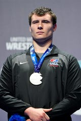 Fowlerville's Adam Coon stands on the podium with his silver medal at the Wrestling World Championships in Budapest, Hungary on Sunday, Oct. 28, 2018.