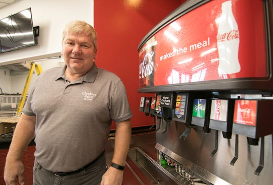 Checkers restaurant franchisee Alan Balen works inside the soon-to-open Hartland business Monday, Oct. 29, 2018 as final touches are put in place.