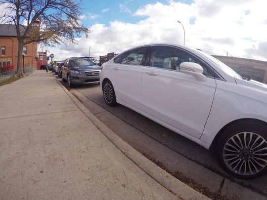 Cars on Main Street park for free Monday, Oct. 29, 2018. Metered parking is one of the possibilities being considered in a study of parking in downtown Brighton.