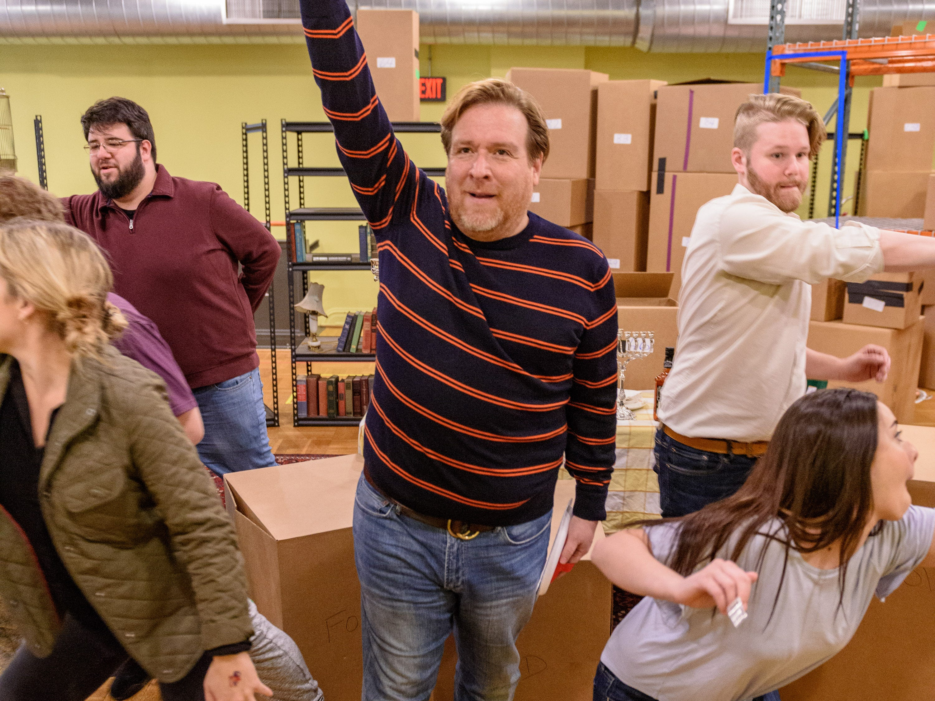 "Actors practice the Hanukkah Party scene in Act 2 as Kentucky Opera works on their production of ""Enemies, A Love Story,"" in their rehearsal space at the Brown Theater. Rabbi Lampert, played by Levi Hernandez, center, is surrounded by party guests, from left, Reilly Nelson as Leah, Tyler Carnes, Dathan Hooper, Adrian Sanchez, Thomas J. Capobianco as Nissen, Murrella Parton as Sheva Haddas, Isaac Pendley and Gabriella Galletti. Oct. 27, 2018"