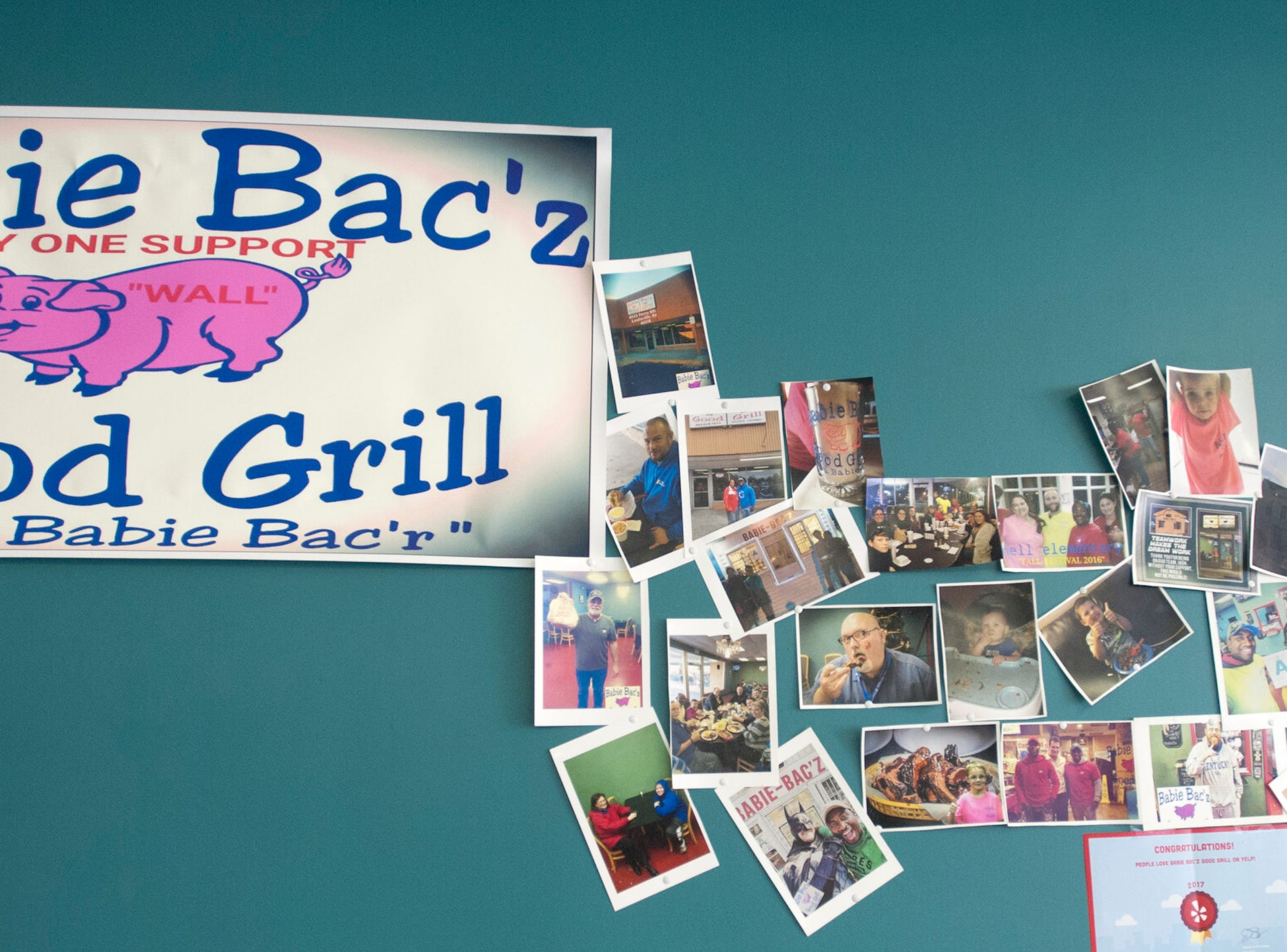 A wall in the Babie Bac'z Good Grill features snapshots of the patrons on the eatery's first day of business, in December of 2017.