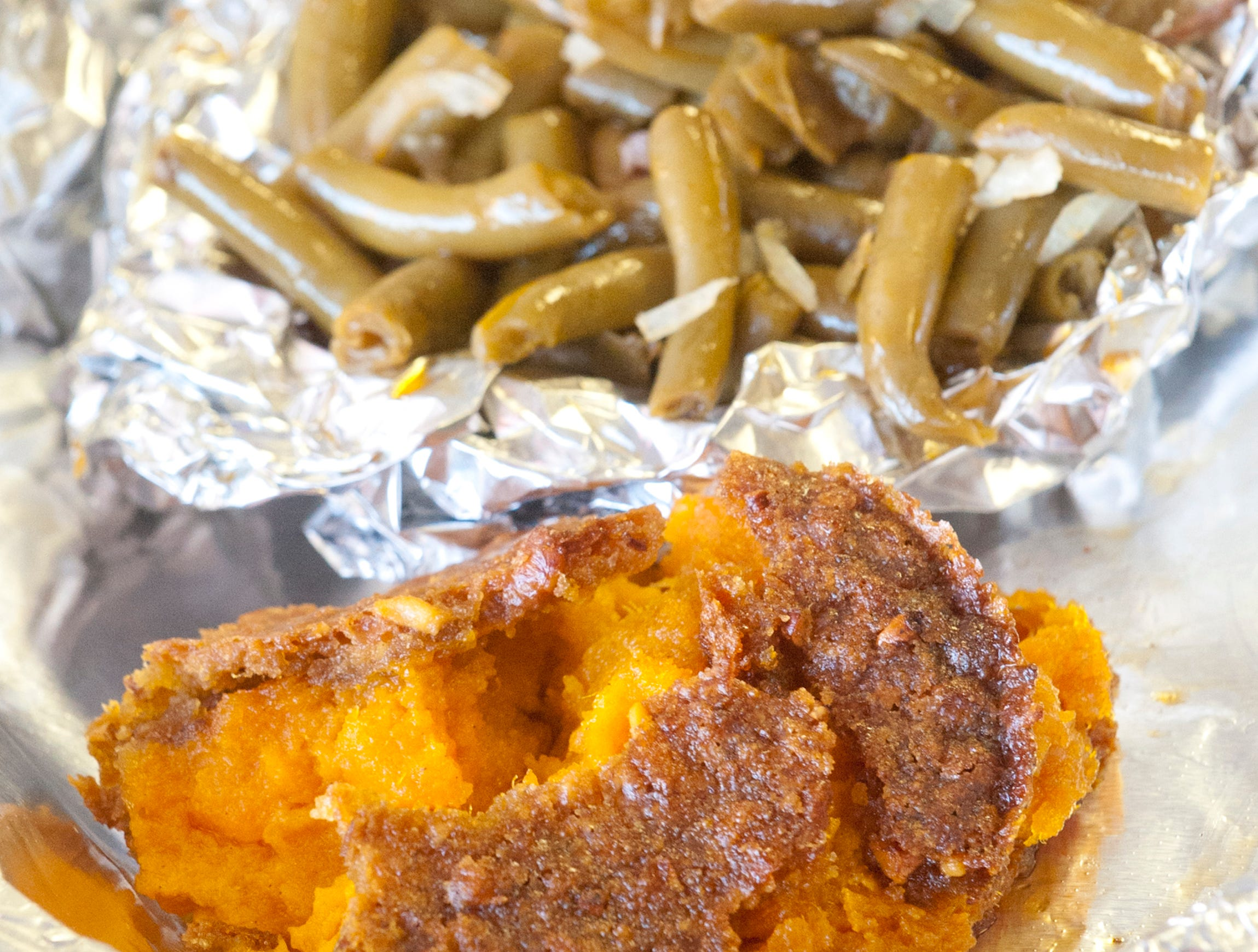 Among the sides at Babie Bac'z Good Grill is its sweet potato casserole made with sweet potatoes, caramelized brown sugar, pecans and cinnamon, and the eatery's home-style green beans made with the restaurant's original dry rub seasoning and jowl bacon.October 24, 2018