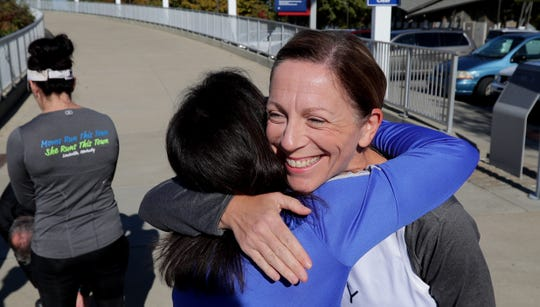Stephanie Boyd (right) hugs Rhonda Braden before a training run.