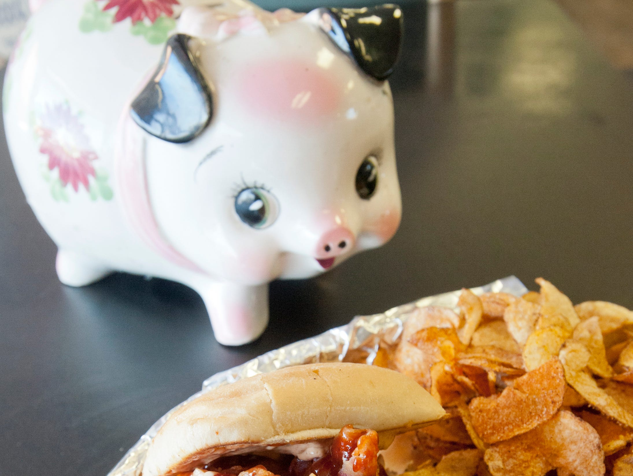 """Babie Bac'z Good Grill's Bac'z Attack sandwich is made with deep fried smoked bacon and pulled pork on a chiabbata bun topped with the eatery's original barbecue sauce. The dish is served with """"Shut Your Mouth"""" potato chips that have been flavored with the restaurant's home-made dry rub.October 24, 2018"""