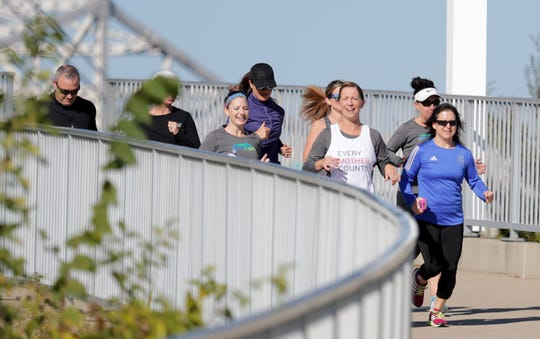Stephanie Boyd and others run in Louisville.