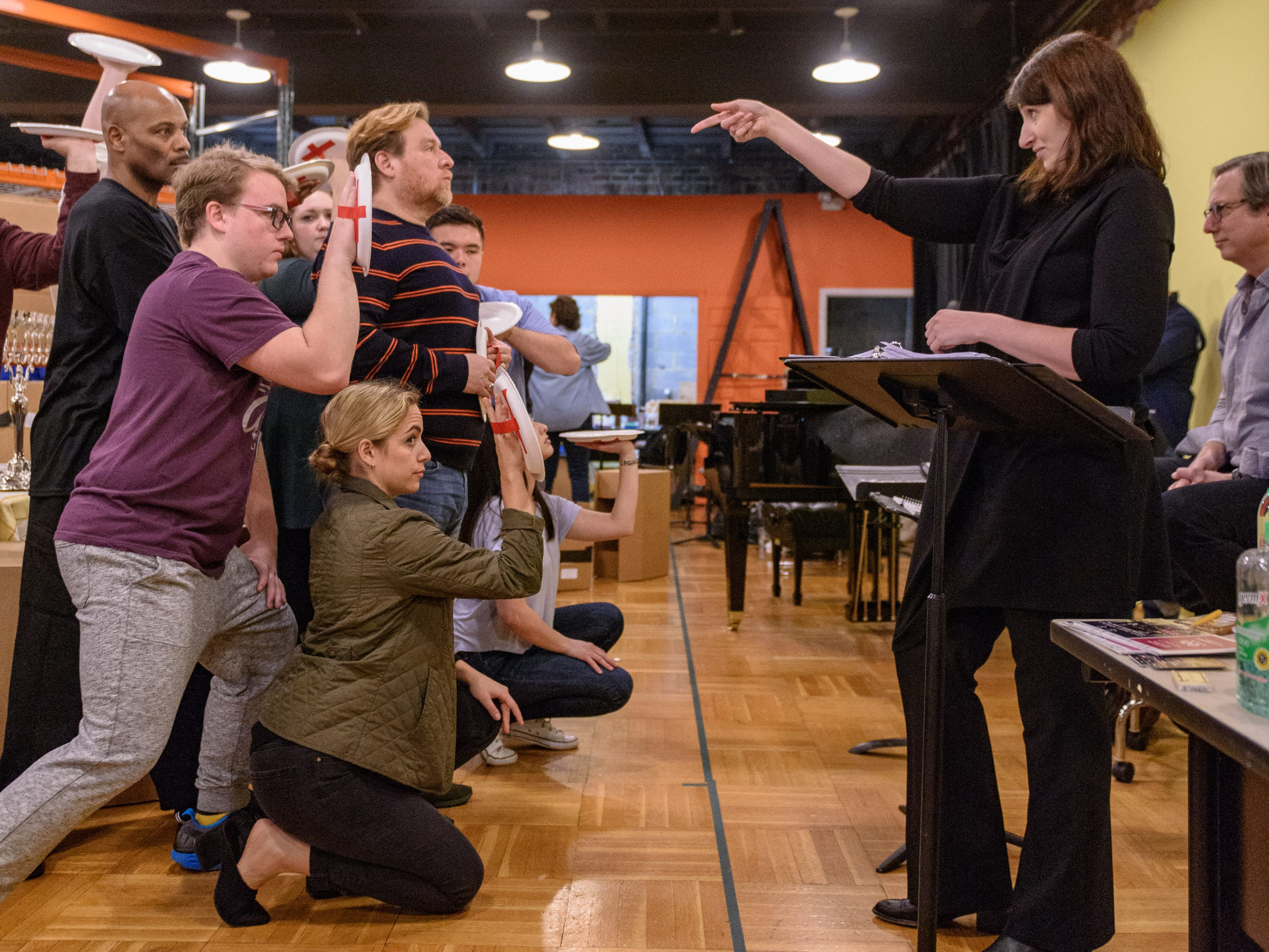Mary Birnbaum directs the Hanukkah Party scene in Act 2 as Kentucky Opera works on their production of ÒEnemies, A Love Story,Ó in their rehearsal space at the Brown Theater. Oct. 27, 2018