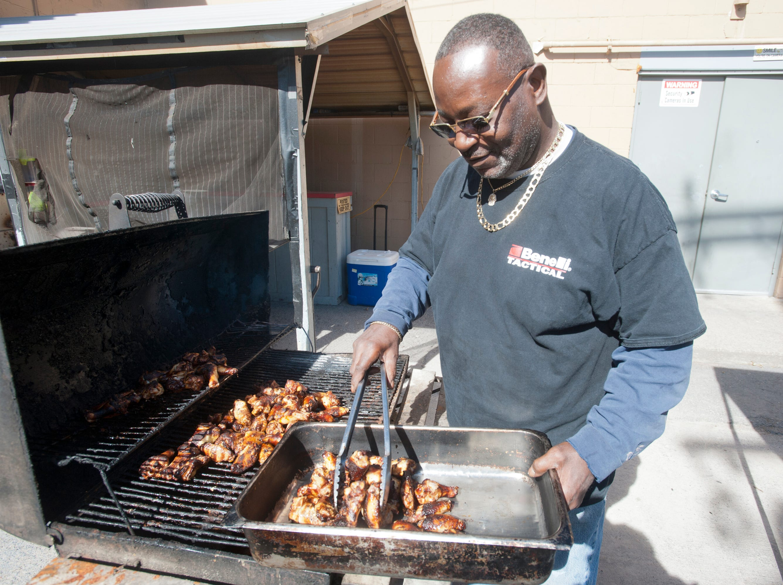 Babie Bac'z Good Grill's co-owner Michael Russell cooks up some barbecued chicken on one of his specialized grills in the back of the restaurant. October 24, 2018