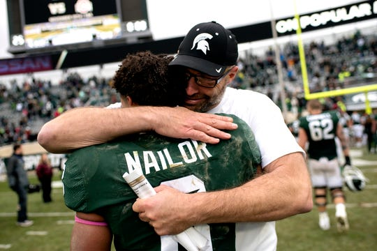 Mark Staten hugs MSU receiver Jalen Nailor after MSU's win over Purdue on Oct. 27. Staten, then the offensive line coach, is now tight ends coach.