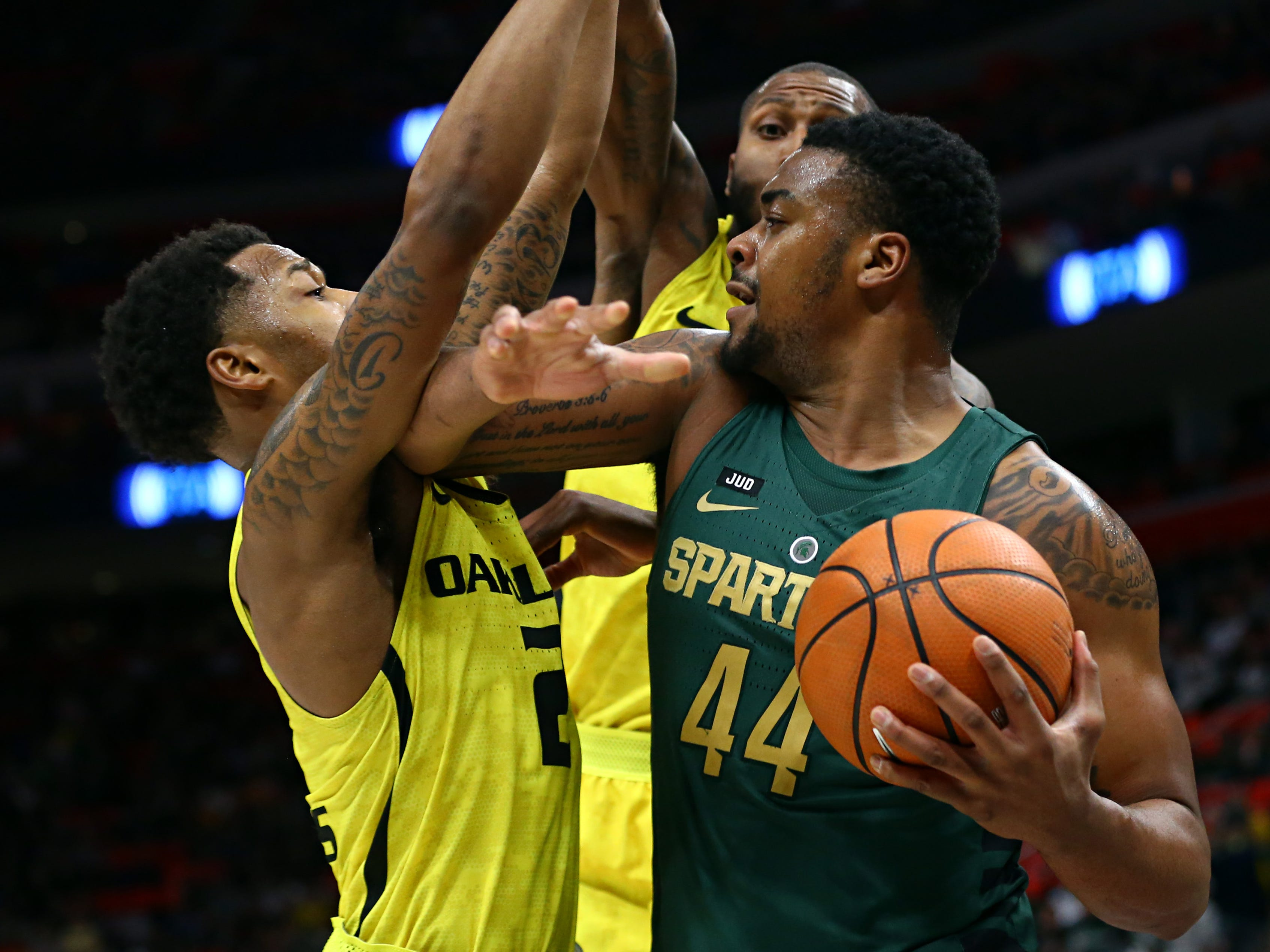 Oakland guard Nick Daniels, left, fouls Michigan State forward Nick Ward in the second half at Little Caesars Arena.   Aaron Doster/USA TODAY Sports Dec 16, 2017; Detroit, MI, USA; Oakland Golden Grizzlies guard Nick Daniels (2) fouls Michigan State Spartans forward Nick Ward (44) in the second half at Little Caesars Arena. Mandatory Credit: Aaron Doster-USA TODAY Sports