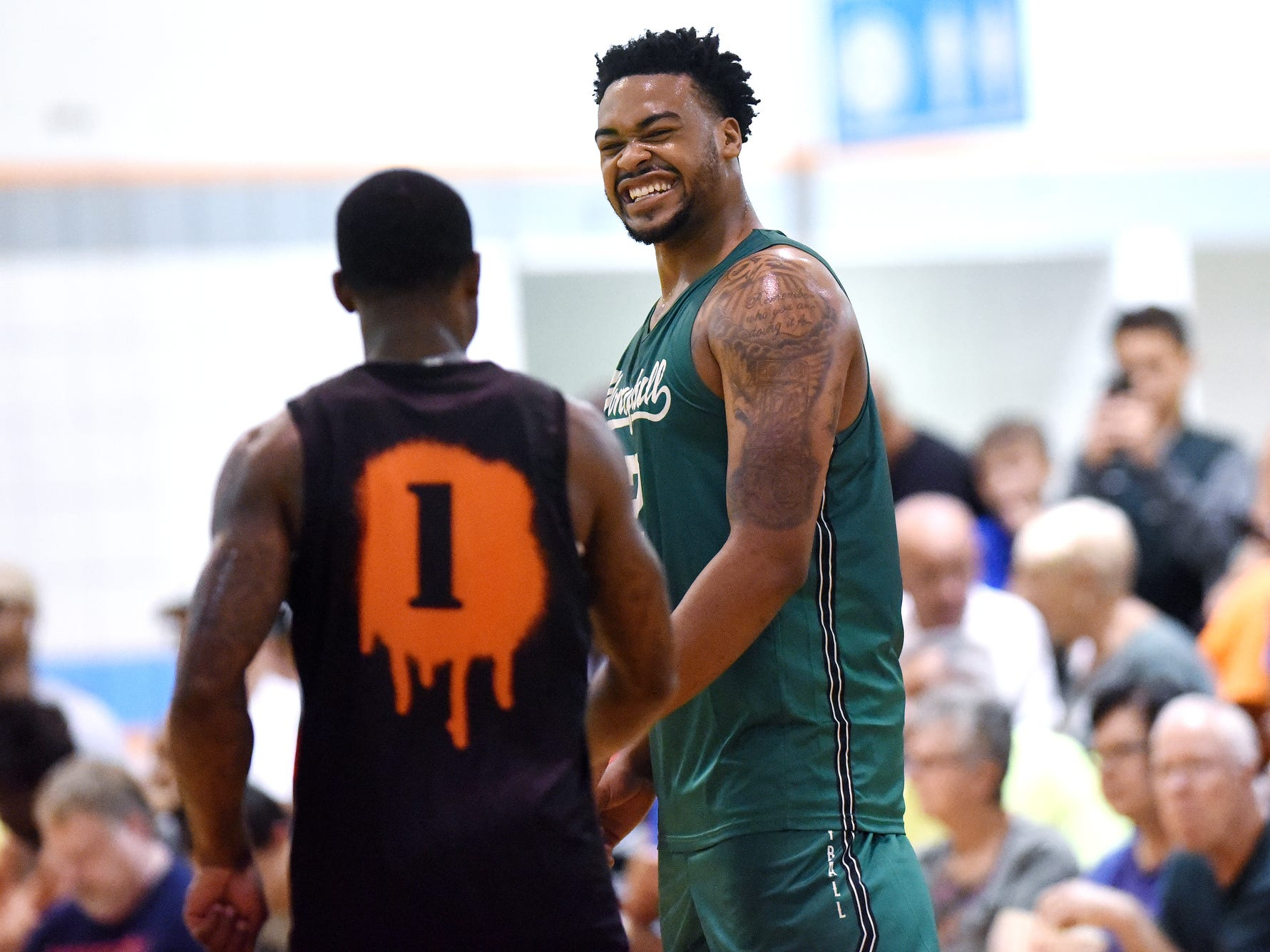 Michigan State center and Team Vintage's Nick Ward, right, jokes with Team Splatter's Kay Felder on Thursday, June 28, 2018, during a Moneyball Pro-Am summer basketball league game at Aim High in Dimondale.