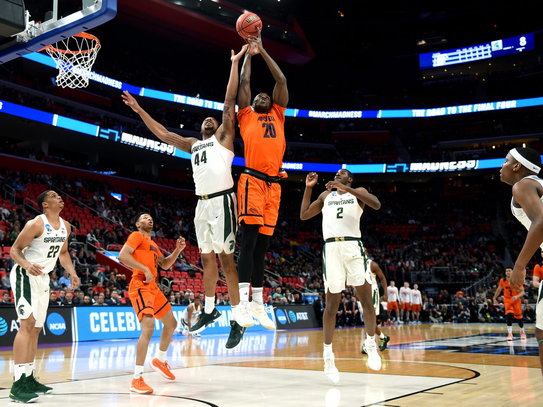 Michigan State's Nick Ward, left, and Bucknell's Nana Foulland, right, go for a rebound during the first half on Friday, March 16, 2018, at the Little Caesars Arena in Detroit.