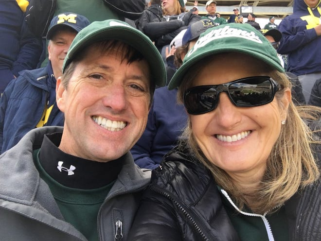 Dan and Tanya Urich smile during the Oct. 20, 2018 MSU-UM game at Spartan Stadium before they discovered the diamond in her wedding ring was missing.