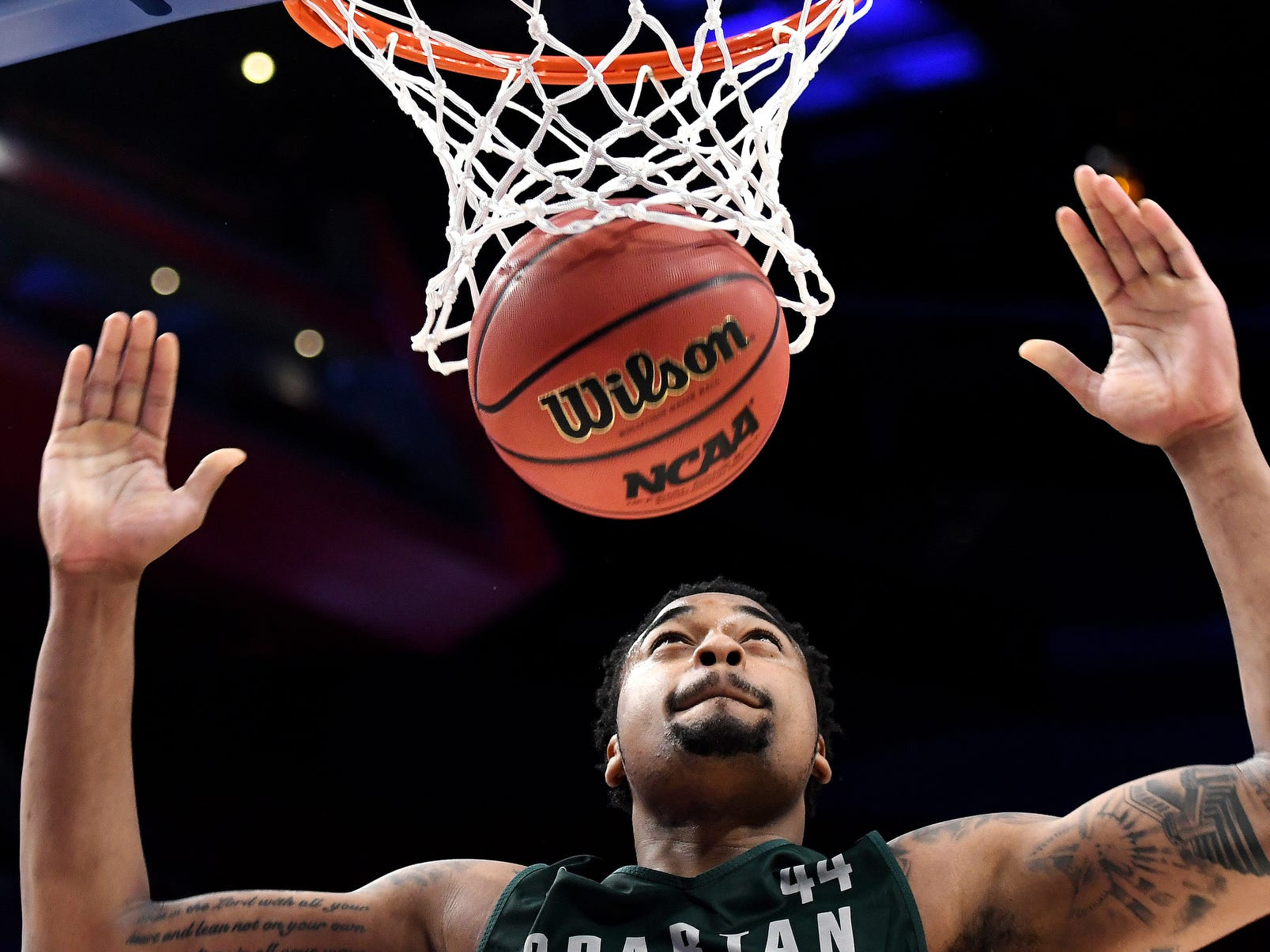 Michigan State's Nick Ward dunks during an open practice on Thursday, March 15, 2018, at the Little Caesars Arena in Detroit.