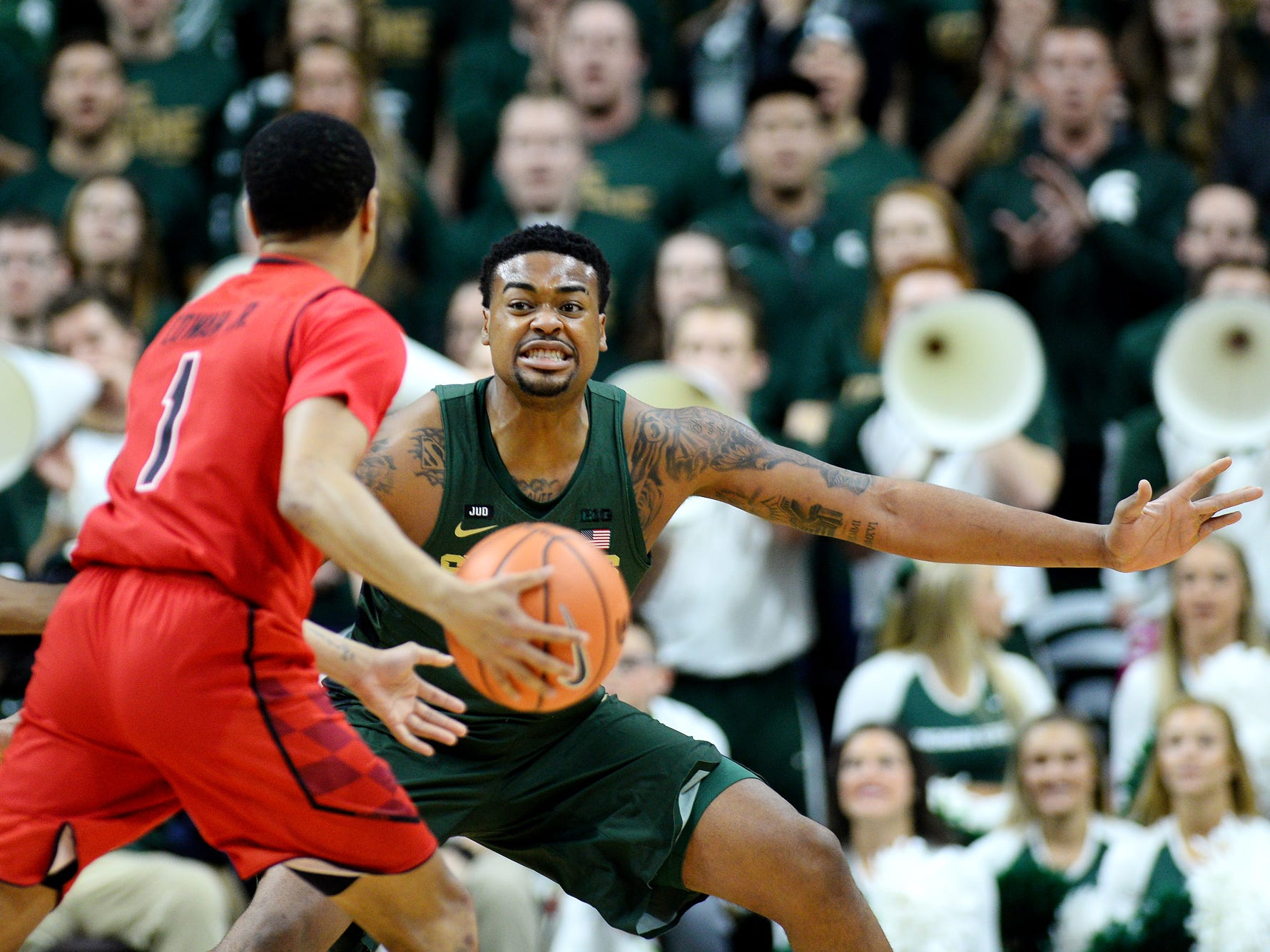 Michigan State's Nick Ward, right, defends as Maryland's Anthony Cowan Jr. looks to pass during the first half on Thursday, Jan. 4, 2018, at the Breslin Center in East Lansing.