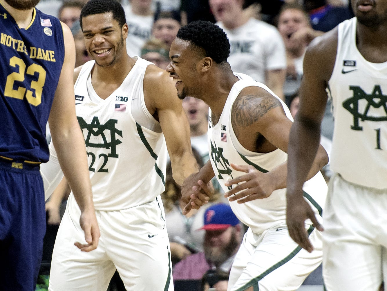 Michigan State's Miles Bridges, left, celebrates after his dunk with teammate Nick Ward during the first half on Thursday, Nov. 30, 2017, at the Breslin Center.