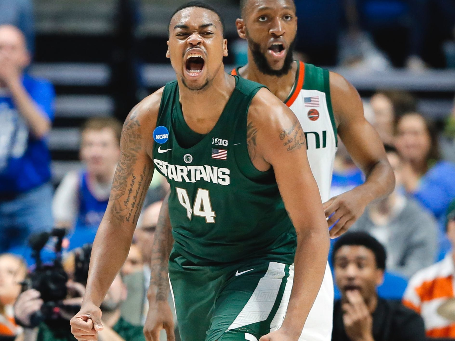 Tony Gutierrez/AP Michigan State freshman Nick Ward celebrates a basket during Friday?s victory. Michigan State freshman Nick Ward celebrates a basket in front of Miami forward Kamari Murphy, rear, in the first half Friday night in Tulsa, Oklahoma. Ward finished with 19 points and seven rebounds.