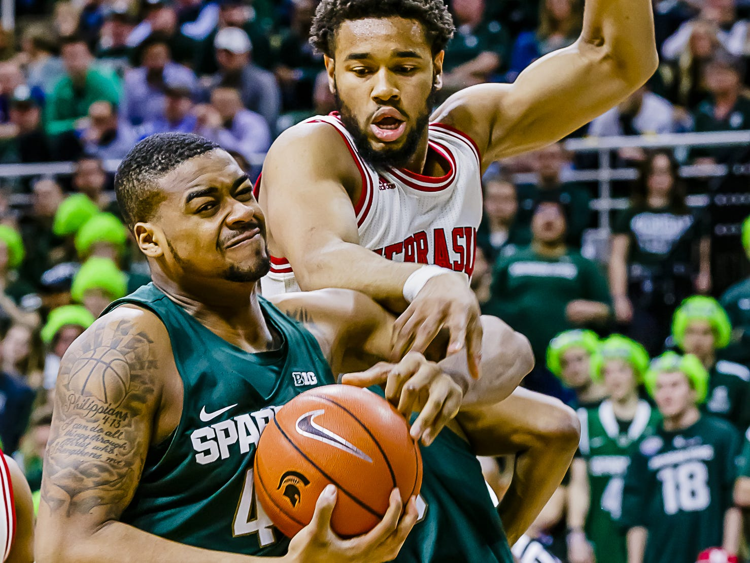 Nick Ward ,left, of MSU grabs a rebound away from Ed Morrow of Nebraska  during their game Thursday February 23, 2017 in East Lansing.  KEVIN W. FOWLER PHOTO