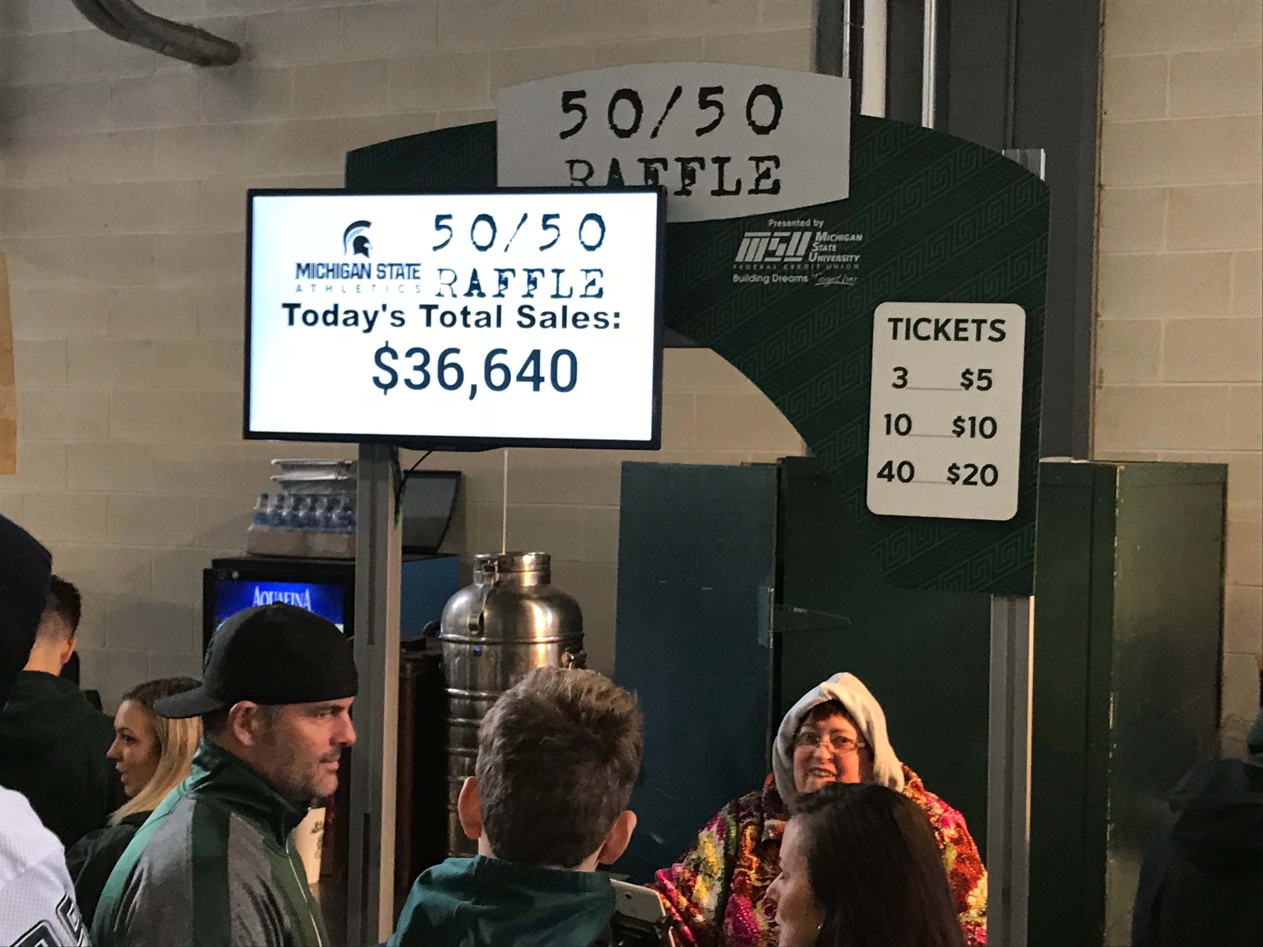 Fans of Michigan State football and other spectators can purchase 50/50 raffle tickets at Spartan Stadium during games.