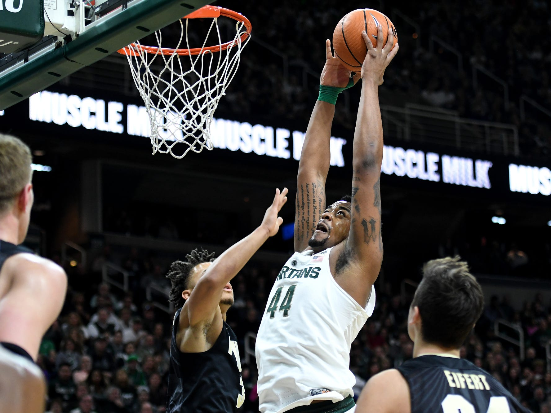 Michigan State's Nick Ward, right, dunks over Purdue's Carsen Edwards during the first half on Saturday, Feb. 10, 2018, at the Breslin Center in East Lansing.