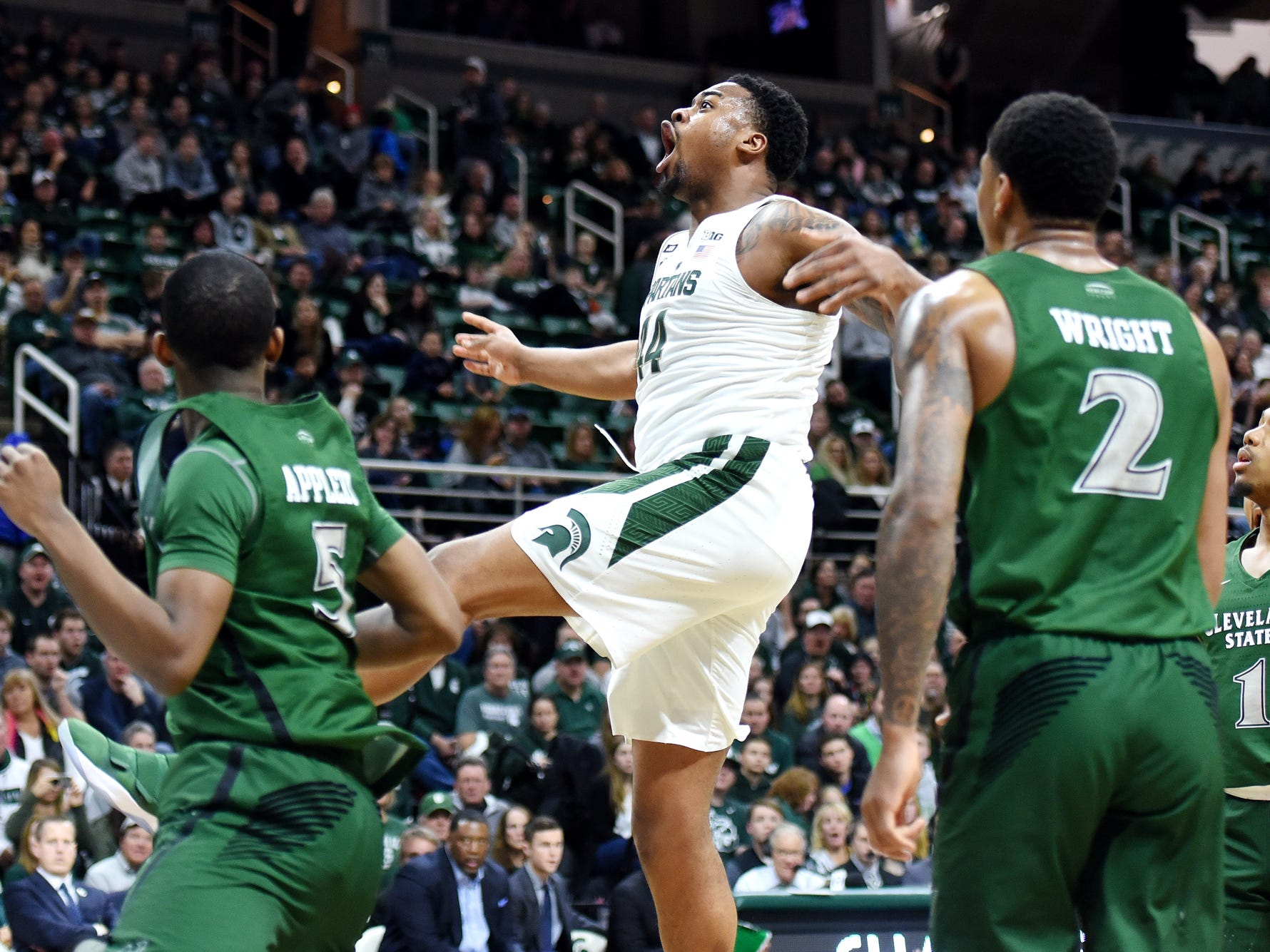 Michigan State's Nick Ward, center, reacts after throwing down a dunk during the second half on Friday, Dec. 29, 2017, at the Breslin Center in East Lansing. The Spartans won 111-61.
