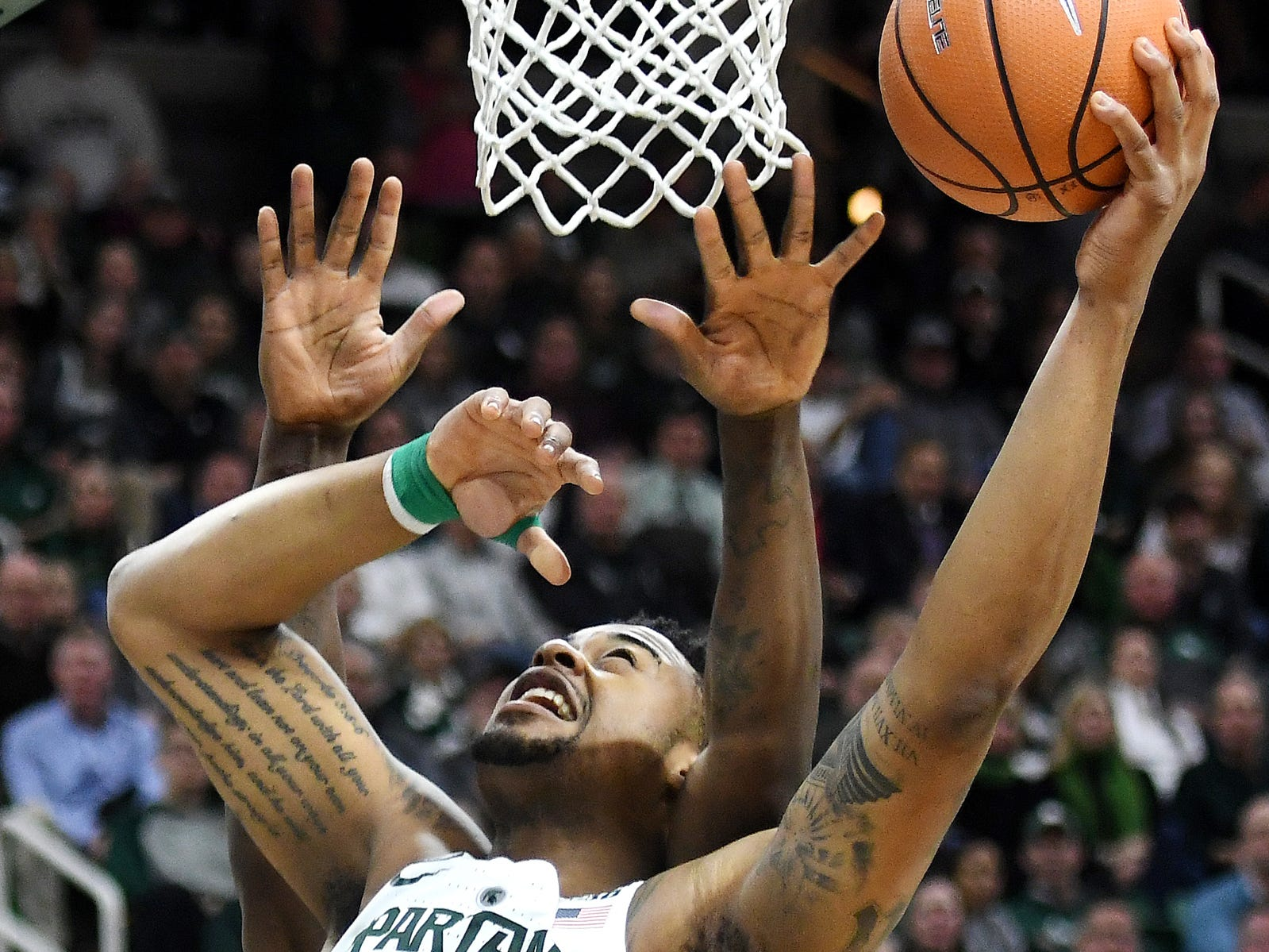 Michigan State's Nick Ward is fouled by Penn State's Mike Watkins while shooting during the second half on Wednesday, Jan. 31, 2018, at the Breslin Center in East Lansing. Ward made the layup. The Spartans won 76-68.